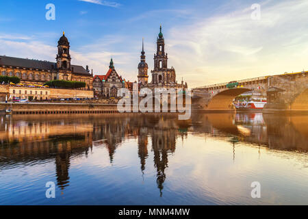 Augustus Bridge (Augustusbrucke) and Cathedral of the Holy Trinity (Hofkirche) over the River Elbe in Dresden, Germany, Saxony. - Stock Photo