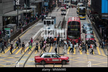 HONG KONG,HONG KONG SAR,CHINA. February 24th 2018.Traffic trams and taxis of Central Hong Kong. Crossroad of Pedder Street and Des Voeux Road central. - Stock Photo