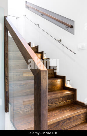 Shot of a broad wooden staircase in a modern house - Stock Photo