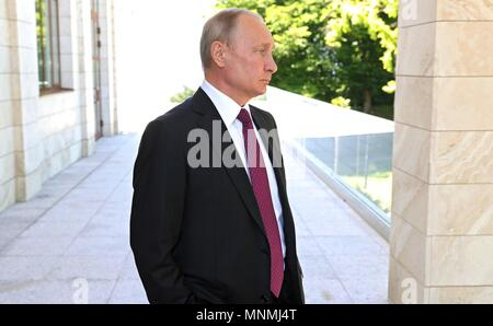 Russian President Vladimir Putin waits to greet Syrian President Bashar al-Assad at his Black Sea resort residence May 17, 2018 in Sochi, Russia.   (Russian Presidency via Planetpix) - Stock Photo