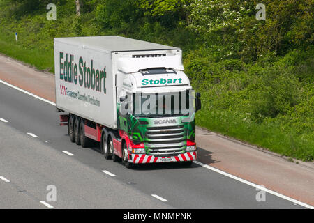 Eddie Stobart Scania heavy goods & commercial traffic, haulage, lorry, transportation, truck, cargo, vehicle, delivery, transport, industry, freight on the M6 southbound, UK - Stock Photo