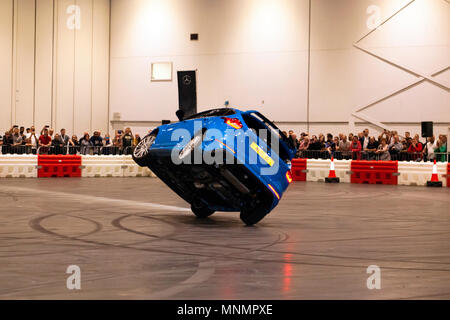 Stunt driver, Paul Swift drives his Ford Focus RS on two wheels, during his live precision driving  show, at London Motor Show 2018. - Stock Photo