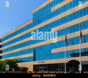ASHEVILLE, NC, USA-13 MAY 18: The seven story, modern-profile Biltmore Corporate office building sets on Pack Square in Asheville, NC, USA. - Stock Photo