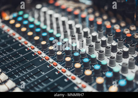 Buttons and knob switches of audio mixer control panel or sound editor, cinematic tone. Digital music technology, concert event, DJ instrumental equip - Stock Photo