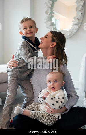 Happy mother spending time with children (18-23 months, 4-5) - Stock Photo