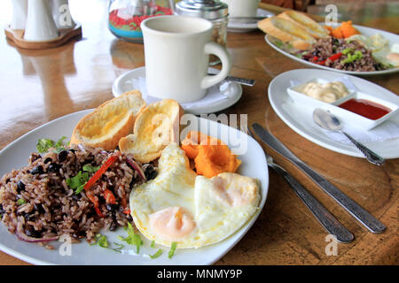 Traditional Gallo Pinto breakfast with eggs, beans and rice in Costa Rica, also in Nicaragua - Stock Photo