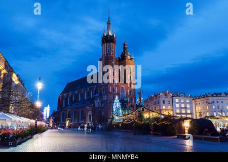 Poland, Malopolskie, Krakow, St Mary's Basilica in town square - Stock Photo