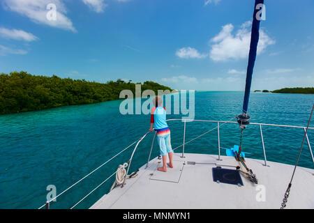 Little boy enjoying ride on a luxury yacht - Stock Photo
