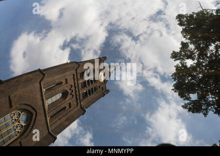 Reflection of a Church in the Netherlands in the car mirror.with a blue sky - Stock Photo