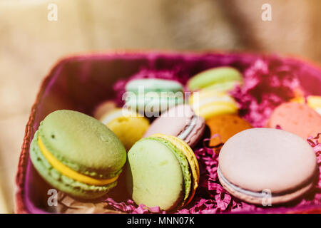 Colorful macaroons. Sweet macarons with copy space for text. Top view, - Stock Photo