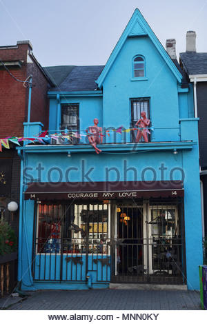 Mannequins on top of a shop in Toronto's famous Kensington Market. Kensington Market is a distinctive multicultural neighbourhood in downtown Toronto, - Stock Photo