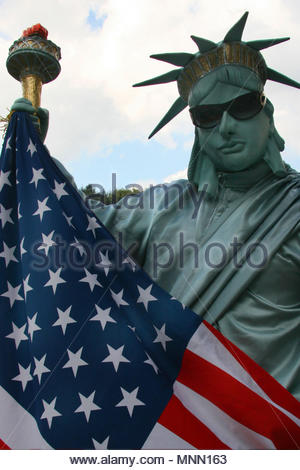 New York, United States of America - A street performer dressed as the Statue of Liberty in Central Park. - Stock Photo