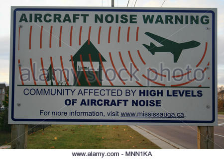 A sign to warn the community of Mississauga in Ontario about the high levels of aircraft noise. - Stock Photo
