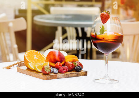 Traditional summer drink sangria - red, pink and white. With champagne, pink and red wine, strawberries, oranges, lemon, green apple and grapefruit. copy space for text.