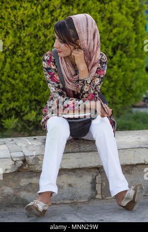 Woman painting in Naqsh-e Jahan Square in Isfahan, Iran. - Stock Photo
