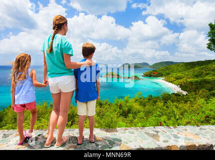 Family of mother and kids enjoying aerial view of picturesque Trunk bay on St John island - Stock Photo