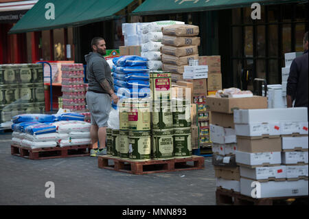 Lisle Street in London's Chinatown with food supplies unloading for local Chinese restaurants. - Stock Photo