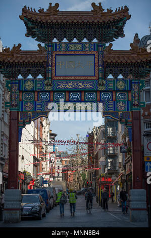 Ornate Chinese gateway to Chinatown in London's West End at Wardour Street. - Stock Photo