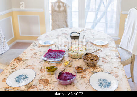 Simple traditional Slavic Russian Ukrainian Orthodox Christmas Eve dinner supper with 12 dishes, celebrated on January 7th, such as Kutia, beet salads - Stock Photo
