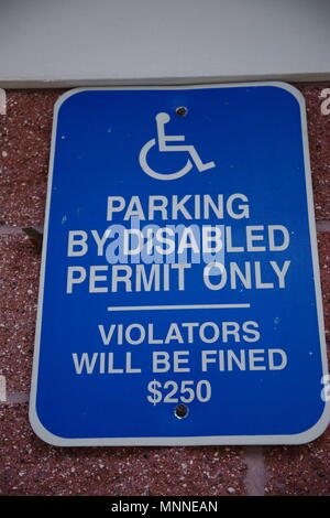 Tampa, Florida / USA - May 5 2018:  Parking By Disabled Permit Only, Violators Will Be Fined $250 - Stock Photo