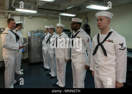 BREMERTON, Wash. (Mar. 14, 2018) Sailors assigned to Engineering Department stand for a Service Dress White inspection aboard USS John C. Stennis (CVN 74). John C. Stennis is in port conducting training preparing for its next scheduled deployment. - Stock Photo