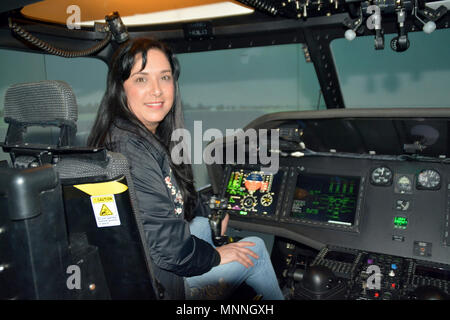 NAVAL AIR STATION JACKSONVILLE – (March 14, 2018) Navy Mom Laura Contreras, a teacher with Douglas MacArthur High School in San Antonio, completes a helicopter simulation mission at the Paul F. Nelson Helicopter Training Facility during Navy Recruiting District San Antonio's annual Educators Orientation Visit (EOV).  The EOV is a Navy Recruiting Command program with a main focus of showing educators the various facets of the Navy and the many career paths available to students. - Stock Photo
