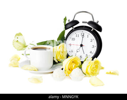 Cup of morning coffee, sweets with coconut flakes, bouquet of yellow roses, white butterfly and black vintage alarm clock isolaled on white background - Stock Photo
