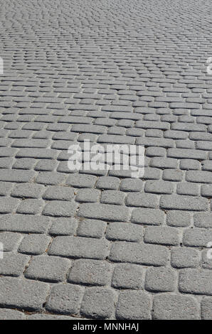 A large area, laid out of paving stone in perspective. Detailed photo of paving stones in the sidewalk avenue close-up - Stock Photo