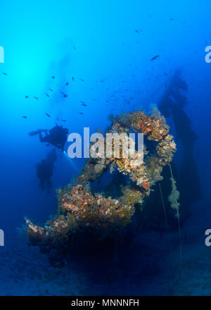 Underwater scene with various scuba divers at the Joker wreck, a deep dive site (-48m) at Ses Salines Natural Park (Formentera,Balearic Islands,Spain) - Stock Photo