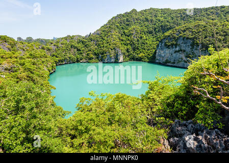 Thale Nai or Blue Lagoon (Emerald Lake) High angle view beautiful nature landscape green sea in the middle of mountain at Koh Mae Ko island viewpoint  - Stock Photo