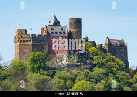 Located on the Rhine River near Oberwesel Germany, Schonburg Castle today serves as a luxury hotel. - Stock Photo