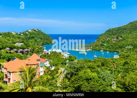 Marigot Bay, Saint Lucia, Caribbean. Tropical bay and beach in exotic and paradise landscape scenery. Marigot Bay is located on the west coast of the - Stock Photo
