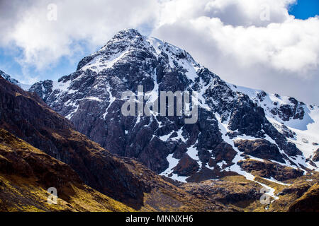The pyramidal peak of Stob Coire nan Lochan in the Bidean nam Bian massif in Glen Coe in the Highlands of Scotland - Stock Photo