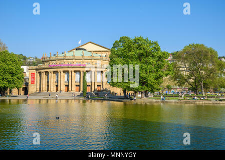 Stuttgart State Theatre Opera building and fountain in Eckensee lake, Germany - Stock Photo