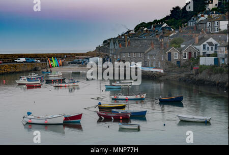 Mousehole, Cornwall, UK. 18th May 2018. UK Weather. Just after sunset it was a mild, calm evening in the harbour at Mousehole. Credit: Simon Maycock/Alamy Live News - Stock Photo