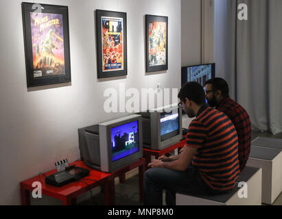 Berlin, Germany. 18th May, 2018. People visit the Computer Games Museum Berlin, in Berlin, capital of Germany, on May 18, 2018. The Computer Games Museum Berlin, which was founded in 1997, displays more than 300 exhibits to allow visitors to experience the development of computer games in decades. Credit: Shan Yuqi/Xinhua/Alamy Live News - Stock Photo