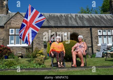 New Mills, Derbyshire, UK, 19th May 2018. Two residents of Inghams Almhouses on Spring Bank, New Mills enjoy the sun before going in to watch the Royal Wedding between Prince Harry and Meghan Markle, soon to become the Duke and Duchess of Sussex. Credit: John Fryer/Alamy Live News - Stock Photo