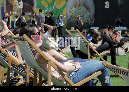 Westfield, White City, London, UK. 19th May 2018. Families enjoy the Royal Wedding Celebrations on a big screen at Westfield. Credit Adam Constantine/Alamy Live News - Stock Photo