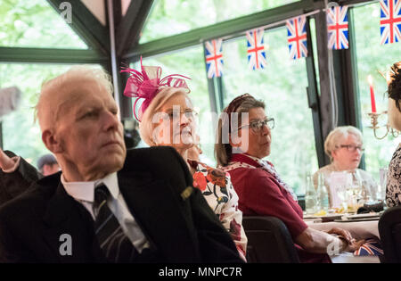 Hanover, Germany, 19 May 2018. People watch the wedding of Prince Harry and Meghan Markle's during a public viewing in a restaurant. The Hanover-British Society holds a private public viewing of the royal wedding. Photo: Peter Steffen/dpa Credit: dpa picture alliance/Alamy Live News - Stock Photo