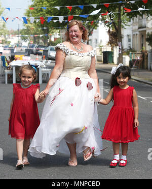 Brighton and Hove, East Sussex, UK. Residents from St Leanoards Road in Brighton and Hove pictured celebrating the royal wedding ceremony of Meghan Markle and Prince Harry at their Street Party.  Saturday 19th May 2018 © Sam Stephenson/Alamy Live News. - Stock Photo