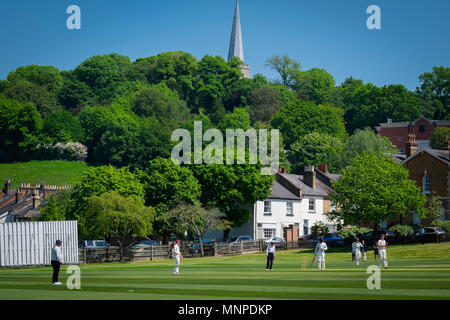 Harrow, London, England, 19th May 2018.  A cricket match is underway on the slopes of Harrow-on-the-Hill on a beautiful spring Saturday © Tim Ring/Alamy Live News - Stock Photo