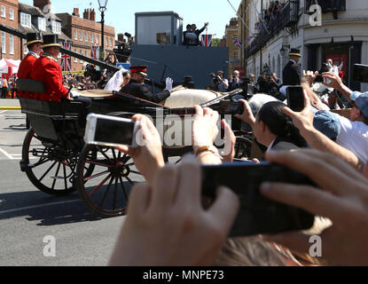 Windsor, UK, 19 May 2018. People with their phones take pictures of The Duke and Duchess of Sussex, Meghan Markle and HRH Prince Harry (of Wales) after their wedding. Royal Wedding of HRH Prince Harry (of Wales) and Meghan Markle, Windsor, Berkshire, on May 19, 2018. Credit: Paul Marriott/Alamy Live News - Stock Photo