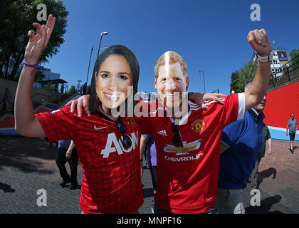 Wembley Stadium, London, UK. 19th May, 2018. FA Cup Final football, Chelsea versus Manchester United; A pair of Manchester United fans posing outside Wembley Stadium wearing HRH Prince Harry and Megan Markle face masks Credit: Action Plus Sports/Alamy Live News - Stock Photo