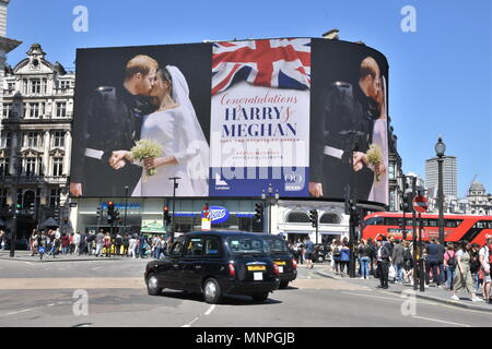 A picture of Prince Harry and Meghan Markle's Wedding in Windsor was displayed on the electronic billboard in Piccadilly Circus,Piccadilly,London.UK 19.05.2018 Credit: michael melia/Alamy Live News - Stock Photo