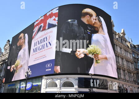 19 May 2018. A picture of Prince Harry and Meghan Markle's Wedding in Windsor was displayed on the giant electronic billboard in Piccadilly Circus, London. UK  Credit: michael melia/Alamy Live News - Stock Photo