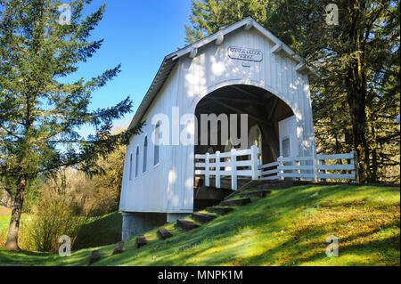 Built in 1926, Ritner Creek Bridge has long been a meeting place for travelers on the Kings Valley Highway in Oregon. - Stock Photo
