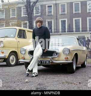 ROGER DALTRY of The Who with his Volvo P1800 Coupe at the Duke of York's HQ in Chelsea,London, on 12 November 1966. The group were making a short film for German TV. Photo: Tony Gale - Stock Photo