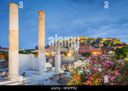 Remains of Hadrian's Library and Acropolis in the old town of Athens, Greece. - Stock Photo