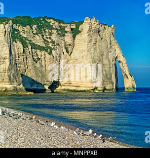 THE ICONIC ARCH PORTE D'AVAL. ETRETAT. NORMANDY. FRANCE. JUNE 2014. The iconic cliffs and the Arch Porte d'aval at the town of Etreat in Normandy made - Stock Photo