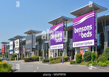 Bensons beds & bedroom furniture shop & sign on Lakeside Retail Park with various furniture & furnishings store beyond West Thurrock Essex England UK - Stock Photo